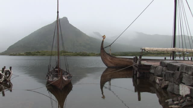 ws view of viking ships in water / lofoten islands / viking museum, norway - viking stock videos and b-roll footage