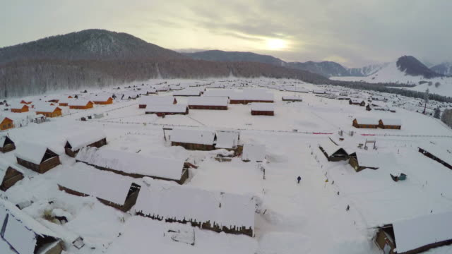 ws aerial view of village after snow,xinjiang,china. - 新疆ウイグル自治区点の映像素材/bロール