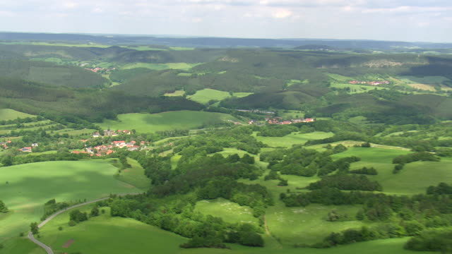 ws aerial zo view of village and hills / germany - zoom out stock-videos und b-roll-filmmaterial