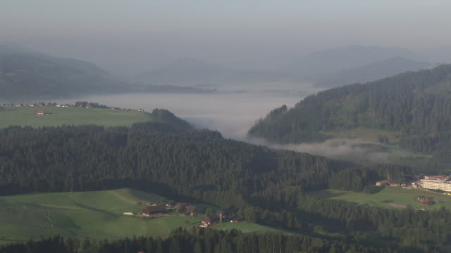 WS POV View of village and mountain with mist / Etzel, Schwyz, Switzerland