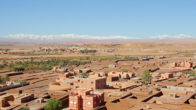 ws view of village below with mountainous skyline / marrakech, tensift, morocco  - moroccan culture stock videos & royalty-free footage