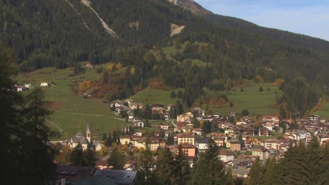 WS, TU, View of Village Moena and snow capped mountains, Trentino Alto Adige, Dolomites, Alps, Italy