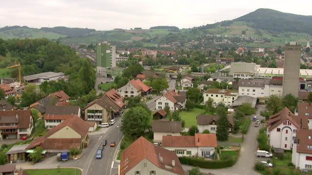 ws aerial view of village of gipf oberfrick with train station, railway and sbb wagon train / wadenswil, zurich, switzerland - station stock-videos und b-roll-filmmaterial
