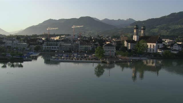 WS AERIAL View of village of lachen coming from obersee in morning sun / Lachen, Schwyz, Switzerland