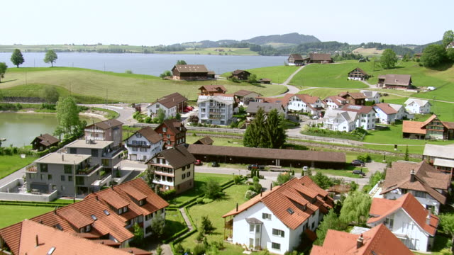 WS AERIAL View of village with lakeside of Lake Sihl / Willerzell, Schwyz, Switzerland