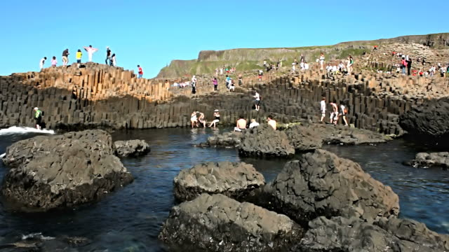 WS View of Visitors at Giant's Causeway on sunny day / Giant's Causeway, Northern Ireland, United Kingdom