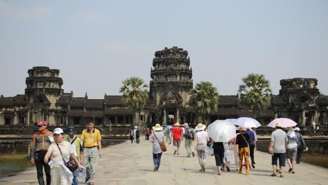 ws view of visitors at temple / angkor wat, siem reap, cambodia - cambodia stock videos & royalty-free footage
