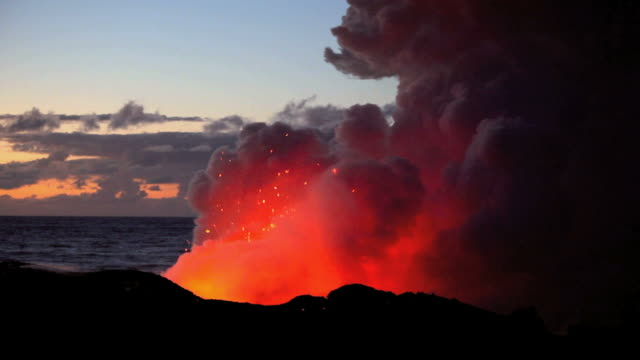 ws view of volcanic eruption with forming steam cloud by ocean at dawn / kalapana, hawaii, usa - eruzione video stock e b–roll