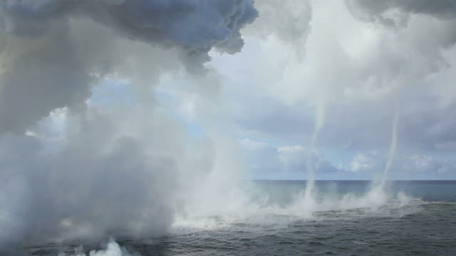 ws view of volcanic steam cloud and twister drifting to ocean / kalapana, hawaii, the big island, usa - stilla havet bildbanksvideor och videomaterial från bakom kulisserna