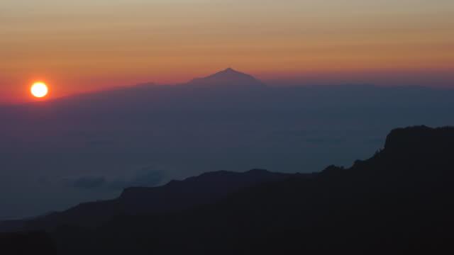 view of volcano teide from roque nublo, tejeda, gran canaria island, canary islands, spain, europe - roque nublo grand canary stock videos and b-roll footage