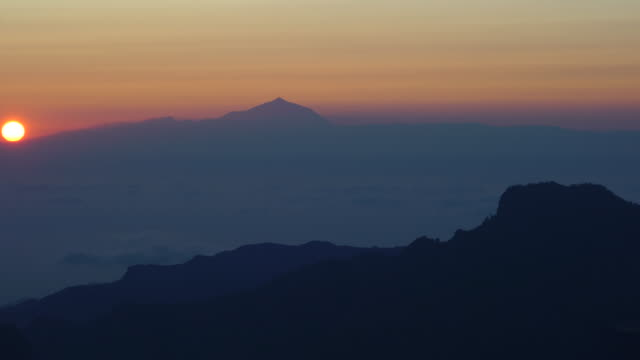 view of volcano teide from roque nublo, tejeda, gran canaria island, canary islands, spain, europe - grand canary stock videos and b-roll footage