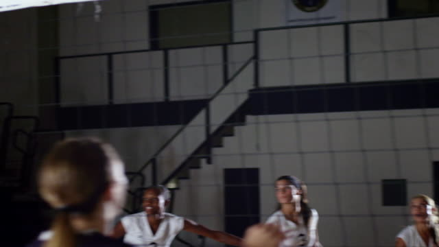 ms pan slo mo view of volleyball match celebrating victory / riverside, california, united states - volleyball sport stock videos & royalty-free footage