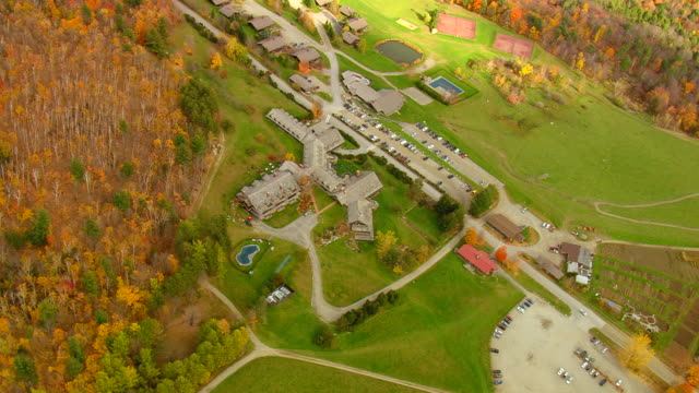 ws aerial zi zo ds view of von trappe family lodge surrounded by tree / vermont, united states - vermont stock videos & royalty-free footage