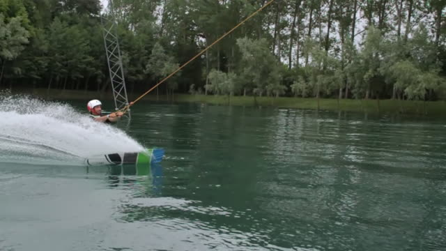 ws slo mo ts view of wakeboard trick at cable park / tencin, haut savoir, france  - waterskiing stock videos & royalty-free footage