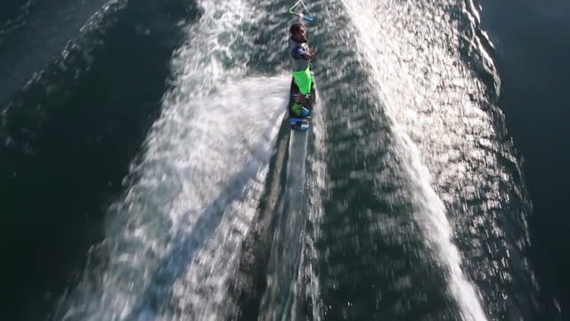 WS AERIAL TS View of wakeboarder and boat wake / geneva, switzerland