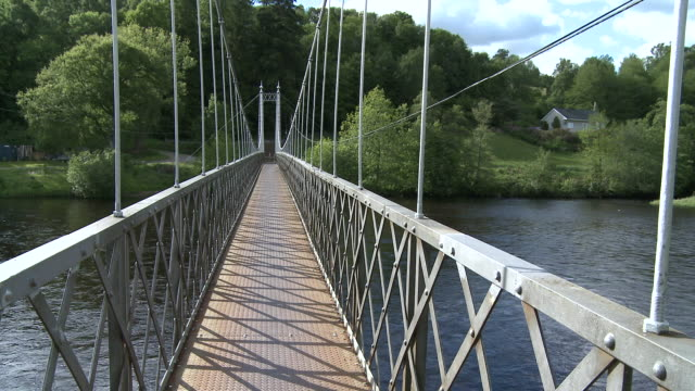 MS View of walking bridge on river / Charlestown of Aberlour, Speyside, Scotland