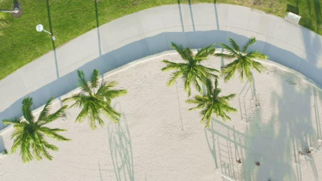 view of walking paths at south beach, miami, florida at sunrise - アールデコ地区点の映像素材/bロール