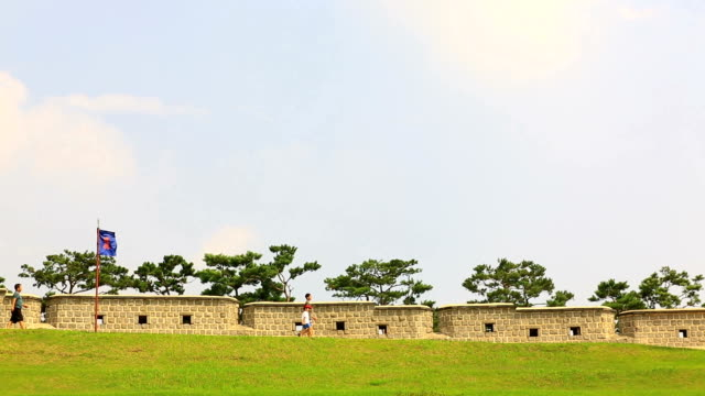 view of walking people at fortified wall in suwon hwaseong castle (unesco world heritage site) - hwaseong palace stock videos and b-roll footage