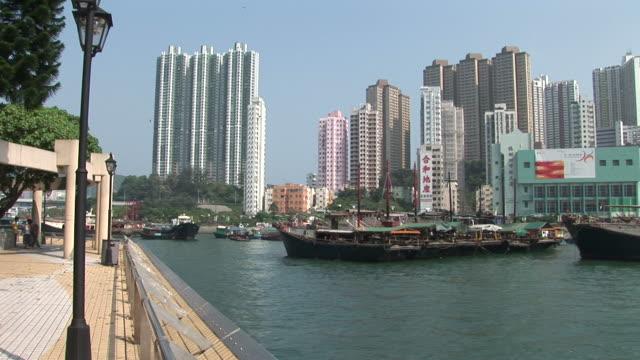 stockvideo's en b-roll-footage met view of walkway in a harbor of hong kong china - voor anker gaan