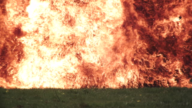 WS SLO MO View of wall of fire produced by exploding petrol can / United Kingdom
