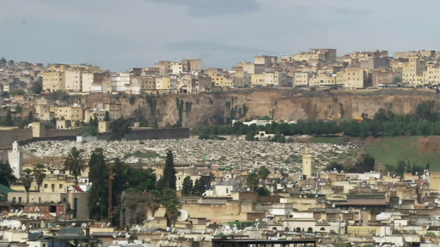 ws view of wall old town and buildings on cliffs above medina / fez, fes-boulemane, morocco - old town stock videos & royalty-free footage