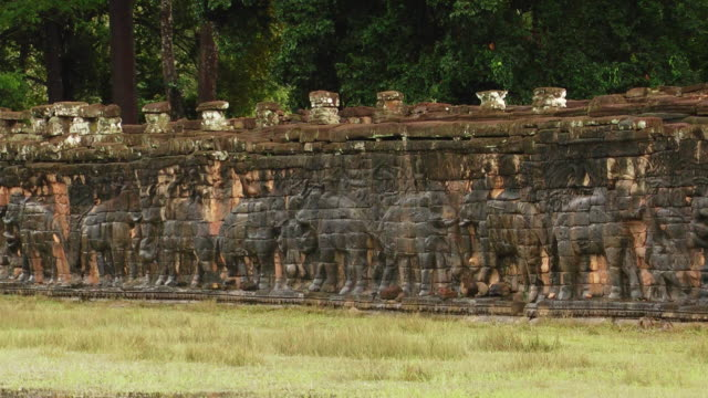 ms pan view of wall with carved elephants at angkor thom temple elephant terrace / siem reap, siem reap province, cambodia - angkor stock videos and b-roll footage