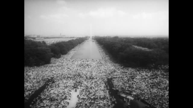 view of washington monument and crowds at the march on washington as they listen to mlk's speech - martin luther king stock videos and b-roll footage