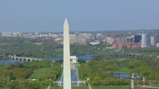 WS ZI AERIAL POV View of Washington Monument and Lincoln Memorial with cityscape / Washington DC, United States