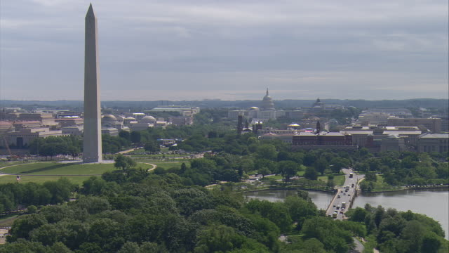 ws aerial view of washington monument with capitol building / washington, dist. of columbia, united states - washington monument washington dc stock videos & royalty-free footage