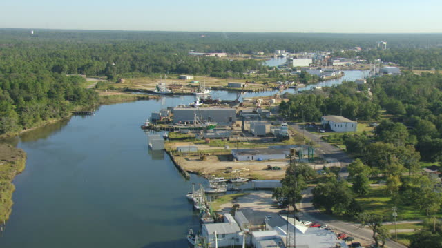 ws aerial view of water and follow channel with boats in mobile county / bayou la batre, alabama, united states - sea channel stock videos and b-roll footage