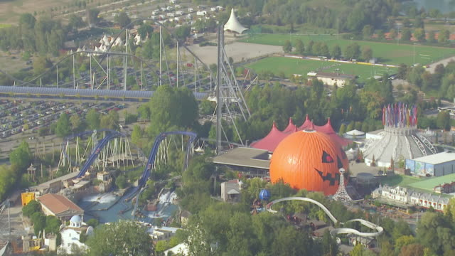 ws aerial zo view of water roller coater ride and pumpkin gnomes in largest theme park / rust, baden wurttemberg, germany - water park stock videos and b-roll footage