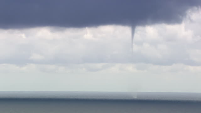 WS View of water spout forms in ocean near village / Giglio Porto, Tuscany, Italy