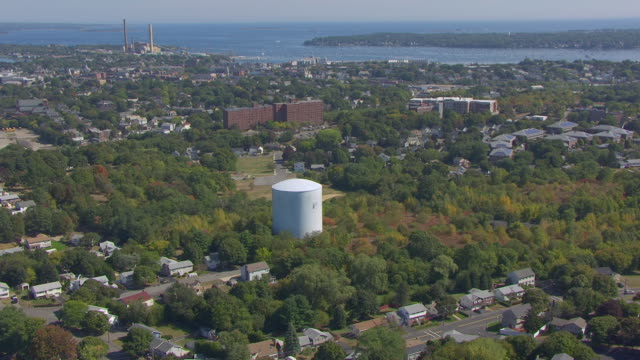 ws aerial pov view of water storage tower at gallows hill park and surrounding salem sound coastwatch / salem, massachusetts, united states - salem stock videos & royalty-free footage