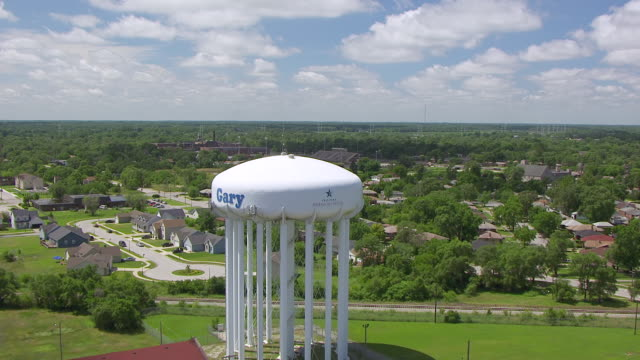 ws aerial pov view of water tower and townscape / lake county, gary, indiana, united states - indiana stock videos & royalty-free footage