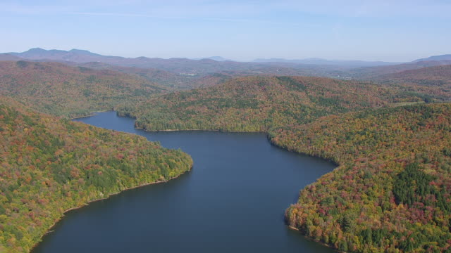 WS AERIAL POV View of Waterbury Reservoir with forest area / Waterbury, Washington County, Vermont, Unites States