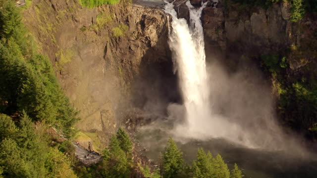 WS AERIAL View of waterfall and rainbow at Snoqualmie Falls / Washington, United States