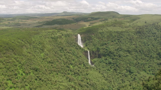 WS AERIAL View of waterfall in dense rainforest / Kenya