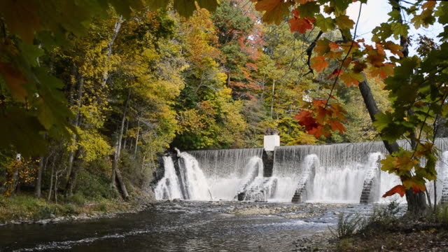 ws t/l view of waterfall showing seasons / high bridge, new jersey, united states - le quattro stagioni video stock e b–roll