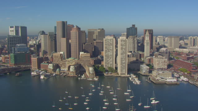 WS AERIAL POV View of waterfront financial district, Boston Harbour in foreground / Boston, Massachusetts, United States