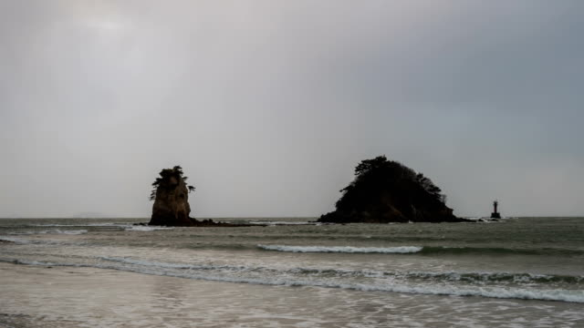 View of wave, tide and boulder at Kkotjihaesuyokjang beach (famous travel destination) in Anmyeondo