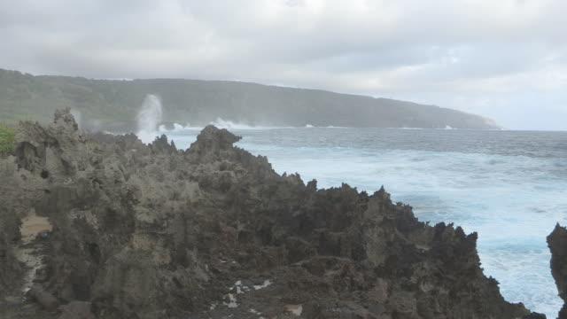 WS View of Waves Crash Against Rocks / Christmas Island, Australia