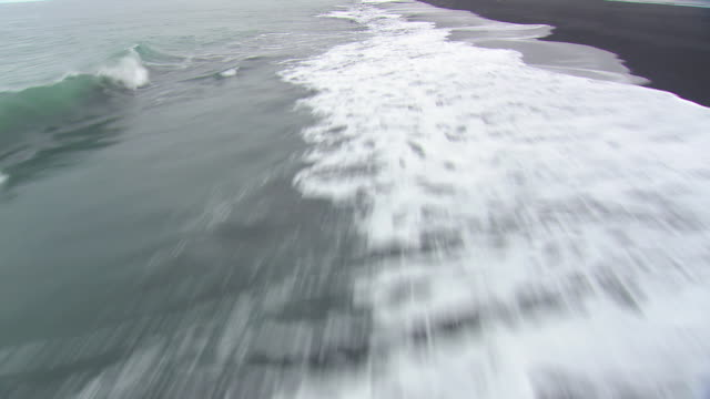 WS AERIAL ZI POV View of waves crashing on South coast / Iceland