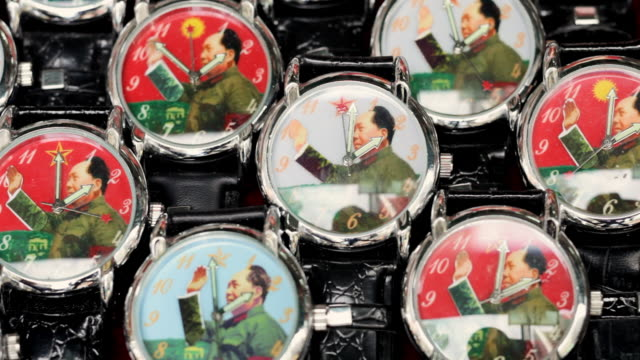 ms view of  waving chairman mao watches / hong kong, china - mao stock videos and b-roll footage