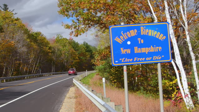 WS View of Welcome sign in Northern New England in fall foliage / New Hampshire, United States
