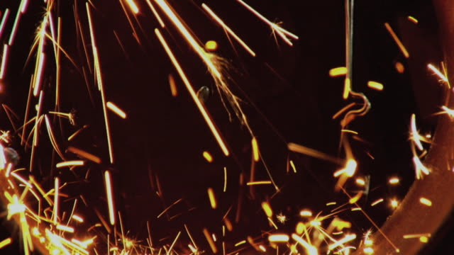 CU SLO MO View of welding sparks / Chico, California, USA