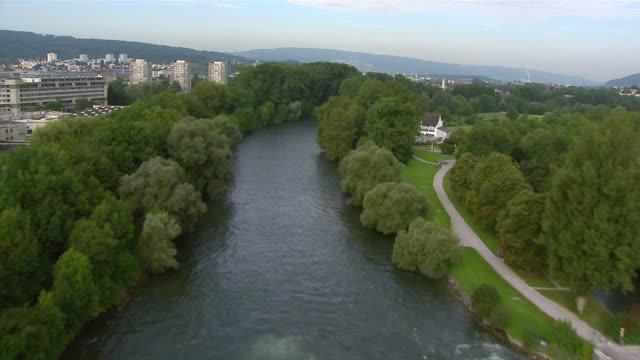 ws aerial view of werd island with hydroelectric power station and europabrucke crossing limmat river / zurich city, zurich, switzerland - kraftwerk stock-videos und b-roll-filmmaterial