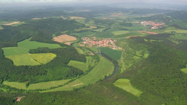 ws aerial view of werra river and houses near national park heinich / germany - fluss stock-videos und b-roll-filmmaterial