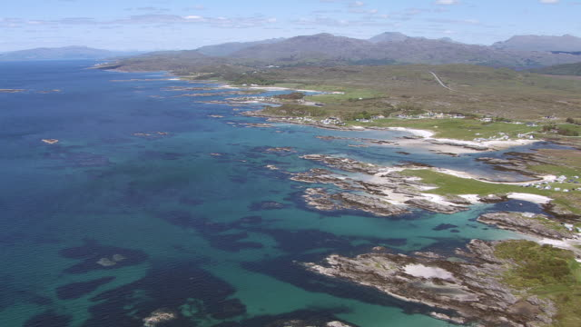ws aerial view of west coast by arisaig showing lovely sandy beaches and caravan park to end on small island / arisaig, inverness shire, scotland - inverness scotland stock videos & royalty-free footage