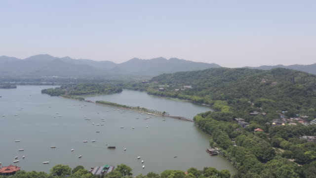 aerial ws view of west lake in hangzhou at daytime / hangzhou, china - invertebrate stock videos & royalty-free footage