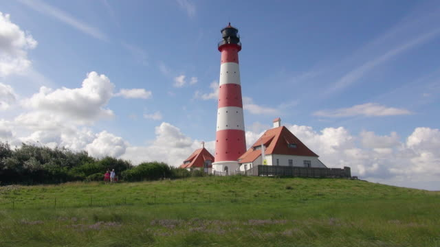 ws la view of westerhever lighthouse from grass field / westerhever, schleswig holstein, germany - schleswig holstein stock videos & royalty-free footage